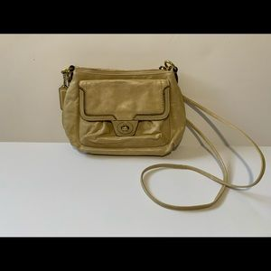 Beige Coach crossbody bag